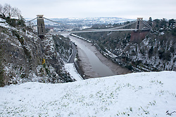 © Licensed to London News Pictures. 18/03/2018. Bristol, UK. The Clifton Suspension Bridge with snow, during a cold weather dubbed the 'mini beast from the east', the second spell of snow and freezing weather to hit the UK in March. Photo credit: Simon Chapman/LNP