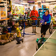 Andrew Whiteford, Heather Goodrich, Jade Goodrich, Micah Goodrich and Courtney Gauthier put together an impromtu ping pong drinking party and bicycle maintenance program in Jackson, Wyoming.
