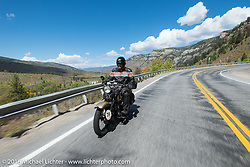 "Robert Gustavsson or ""Big Swede"" as he is fondly known, riding his 1931 Harley-Davidson VL during Stage 10 (278 miles) of the Motorcycle Cannonball Cross-Country Endurance Run, which on this day ran from Golden to Grand Junction, CO., USA. Monday, September 15, 2014.  Photography ©2014 Michael Lichter."