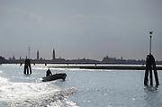 Fisherman's boat on the Canale della Giudecca. Venice, Italy, Europe