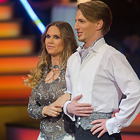 "Hajnalka Majros ""Dundika"" and Mate Meszaros dance in the live broadcast celebrity dancing talent show Saturday Night Fever by Hungarian television company RTL II in Budapest, Hungary on March 16, 2013. ATTILA VOLGYI"