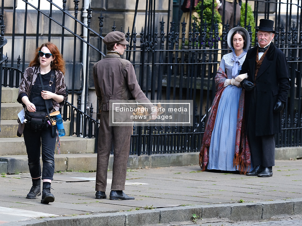 """Moray Place in Edinburgh's Georgian old town was turned into 19th century London for Julian Fellowes' new ITV show """"Belgravia"""".<br /> <br /> Pictured: Extras have a break between takes<br /> <br /> Alex Todd   Edinburgh Elite media"""