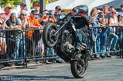 Stunt Rider Jason Thompson at the Harley-Davidson downtown Sturgis display during the annual Black Hills Motorcycle Rally. SD, USA. August 9, 2014.  Photography ©2014 Michael Lichter.