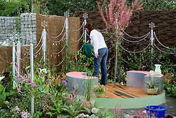 Watering in preparatiion for the Chelsea Flower Show. The Crystal Cobweb Garden. Designer:  Freya Lawson - Chelsea 2005