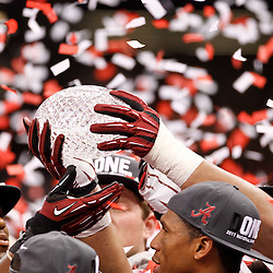 Jan 9, 2012; New Orleans, LA, USA; Alabama Crimson Tide hand around The Coaches Trophy crystal ball after the 2012 BCS National Championship game win over the LSU Tigers at the Mercedes-Benz Superdome.  Mandatory Credit: Derick E. Hingle-US PRESSWIRE