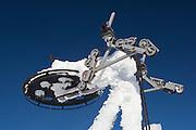 Decommissioned lift pylon encased in ice, near the top of ski field Turoa. Turoa is located on active volcano Mount Ruapehu, New Zealand.