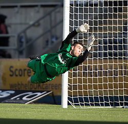 Alloa Athletic's keeper Craig McDowall can't stop Falkirk's Luke Leahyshotfor their second goal.<br /> Falkirk 2 v 1 Alloa Athletic, Scottish Championship game played 4/10/2014 at The Falkirk Stadium.