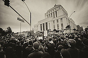 Thousands of people rally outside the Alameda County Court House for a protest.