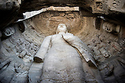 A giant statue of Buddha is seen at the ancient Chinese Buddhist temple grottoes of Yungang (simplified Chinese: 云冈石窟 ; pinyin: Yúngāng Shíkū) in Datong, China, July 24, 2014.<br /> <br /> Confucianism, Taoism and Buddhism are the three major religions in China. Temples and statues witness their ancient roots all over the Chinese country.<br /> <br /> © Giorgio Perottino