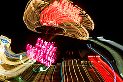 """""""Tahoe Lights 1"""" - Photograph taken at the Lake Tahoe northern state line casinos. The look was achieved by shooting a handheld long exposure and zooming the lens during the exposure."""