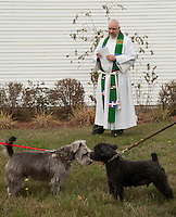 With Pastor Dave Dalzell looking on Schroeder and Tiger exchange greetings Sunday morning during the blessing of the animals and soil celebration at the Good Shepherd Lutheran Church.  (Karen Bobotas/for the Laconia Daily Sun)