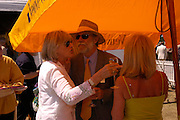 The Countess of Westmorland and Viscount Cowdray. Veuve Clicquot Gold Cup Final at Cowdray Park. Midhurst. 17 July 2005. ONE TIME USE ONLY - DO NOT ARCHIVE  © Copyright Photograph by Dafydd Jones 66 Stockwell Park Rd. London SW9 0DA Tel 020 7733 0108 www.dafjones.com