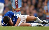 Photo: Paul Greenwood.<br />Everton v Aston Villa. The Barclays Premiership. 11/11/2006. Everton player Tim Cahill lies injured on the ground.