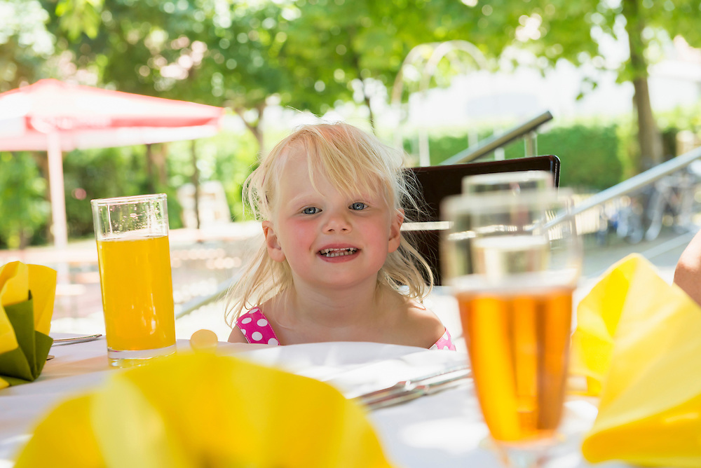 Little girl sitting at laid table