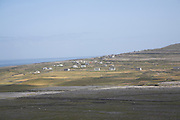 View of scattered houses and farms on rocky limestone land from Dún Aengus fort Inishmore, Aran Islands, County Clare, Ireland