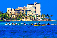 Outrigger canoes and surfers in the waters off Waikiki Beach (Diamond Head crater in background), Honolulu, Oahu, Hawaii, USA
