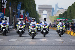 Female motor outriders lead the peloton during the La Course, a 89 km road race in Paris on July 24, 2016 in France.
