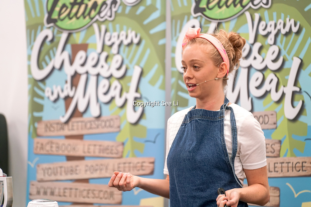 Poppy Lettuce demo some of her quick & easy cheese recipes using ingredients nacho cheese sauce the Vegan Cheese party at Olympia London on the 21st October 2017