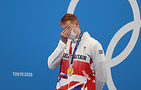 TOKYO, JAPAN - JULY 27: Tom Dean of Great Britain is seen on the podium after winning gold in the Men's 200m Freestyle final on day four of the Tokyo 2020 Olympic Games at Tokyo Aquatics Centre on July 27, 2021 in Tokyo, Japan.<br /> <br /> Credit: COLORSPORT/Ian MacNicol