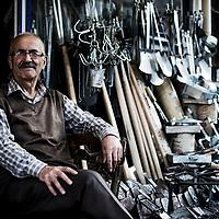 Welder outside his ironmonger shop, Black Sea region, Turkey.