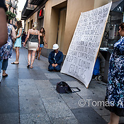 The Spanish economic crisis of 2008, and the subsequent bursting of the real estate bubble, had an enormous impact on building workers, who lost their jobs by the thousands. A construction worker begging for food in one of Barcelona's main shopping streets.