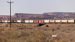 Freight Train Movement Eastbound along Historic Route 66 in Western New Mexico. BNSF Railroad Locomotives 4485 and 4921 pulling the load.