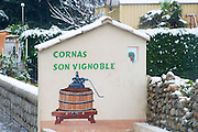 At the entrance to Cornas, a wall painting showing a wine press and welcoming you to Cornas , Ardeche, Ardèche, France, Europe