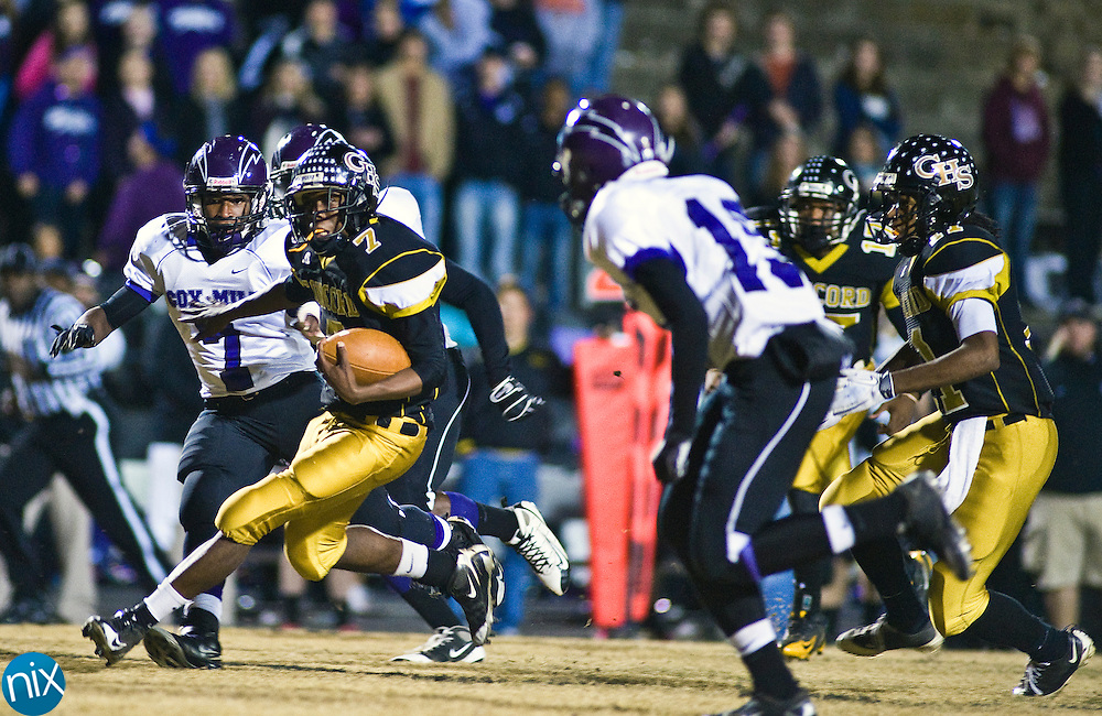 Concord's Varen Blake carries the ball against Cox Mill during the first round of the NCHSAA 3A playoffs Friday night at Concord High School. Concord won the game 30-12 to advance. (Photo by James Nix)