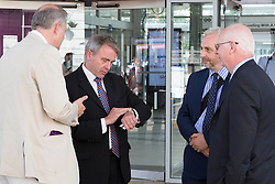 Image ©Licensed to i-Images Picture Agency. 04/07/2014. <br /> <br /> Under Secretary for transport  MP Robert Goodwill checks his watch after arriving late and his train being cancelled.<br /> <br /> MP Robert Goodwill arrives in Peterborough, with Ian Bates Cambs County Counciillor, Simon Machen Peterborough city Council and MP Stewart Jackso, after traveling the entire A47 from Gt Yarmouth to Peterborough.<br /> <br /> Picture by Terry Harris / i-Images