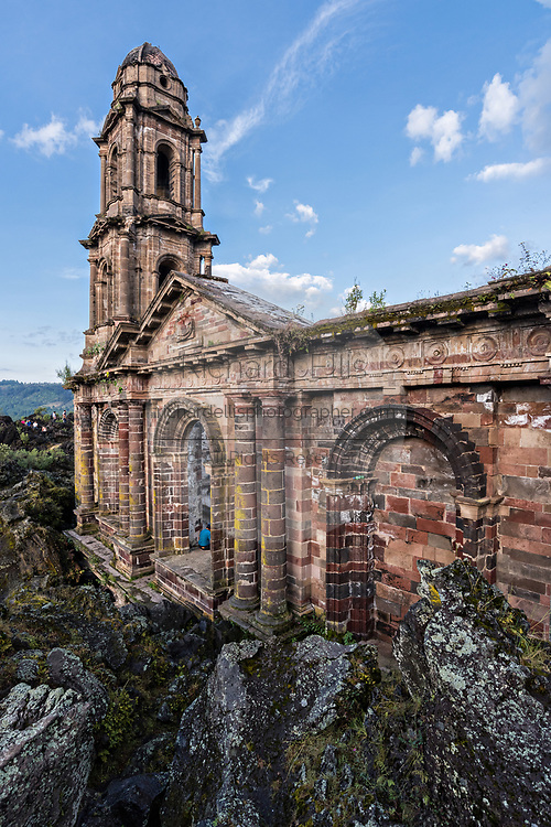 The steeple of San Juan Parangaricutiro church pokes up out of a sea of dried lava rock in the remote village of San Juan Parangaricutiro, Michoacan, Mexico. This church is the only remaining structure left buried in the eight-year eruption of the Paricutin volcano which consumed two villages in 1943 and covered the region in lava and ash.