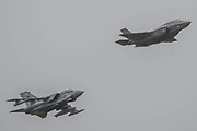 A Tornado and a Lightning II make a 617 Squadron fly past - The Duxford Battle of Britain Air Show is a finale to the centenary of the Royal Air Force (RAF) with a celebration of 100 years of RAF history and a vision of its innovative future capability.