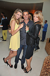Left to right, GRETA BELLAMACINA, LYNDON LEA founding partner of Lion Capital LLP and SOPHIE DICKENS at the Veuve Clicquot Mint Polo in The Park after party held at The Hurlingham Club, Ranelagh Gardens, London SW6 on 5th June 2011.