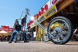 Siouxicide Choppers' Dana Menefee with his 1968 Shovelhead with its Sugar Bear built 60 inch over front end at the Broken Spoke area of the Sturgis Iron Horse Saloon during the Sturgis Black Hills Motorcycle Rally. Sturgis, SD, USA. Sunday, August 4, 2019. Photography ©2019 Michael Lichter.