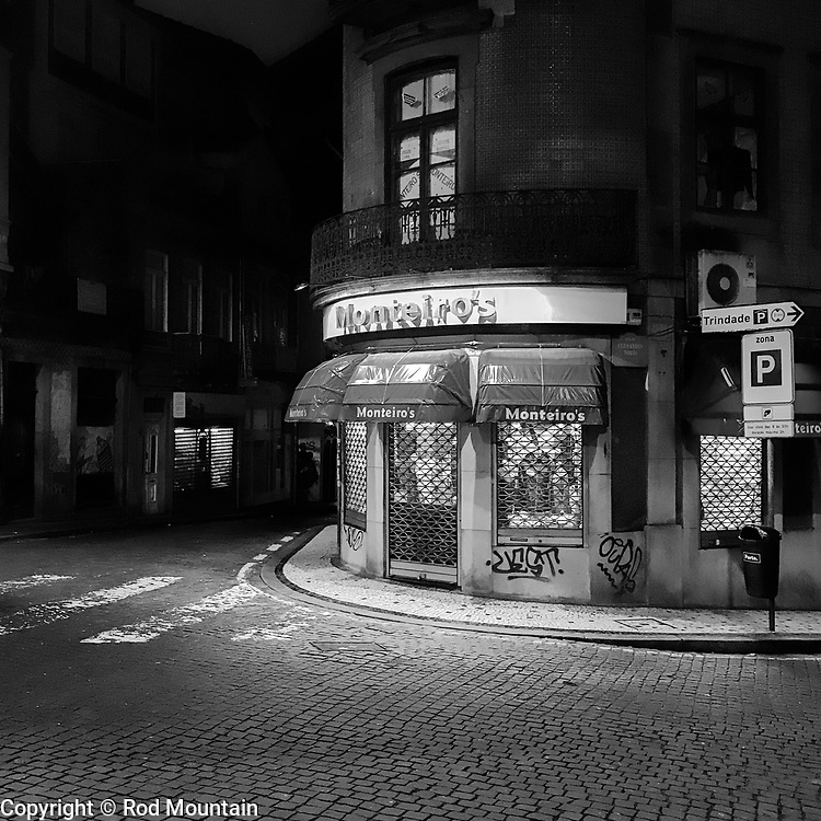 Porto, Portugal - February 13, 2018 - Shops are all closed for the evening…<br /> <br /> Image: © Rod Mountain<br /> <br /> http://www.rodmountain.com <br /> <br /> http://bit.ly/RM-archive<br /> <br /> http://bit.ly/Porto-BW<br /> <br /> http://bit.ly/Porto_PT<br /> <br /> Instagram<br /> @visitportugal <br /> <br /> FaceBook<br /> @visitportugal <br /> @visitporto.portal<br /> @TurismoPortoNortePortugal<br /> @TurismodePortugal<br /> @CamaraMunicipaldoPorto<br /> <br /> Twitter<br /> @visitportugal <br /> <br /> Pinterest<br /> @visitportugal <br /> <br /> http://www.portoenorte.pt/en/<br /> https://en.wikipedia.org/wiki/Porto<br /> https://www.visitportugal.com/en<br /> https://en.wikipedia.org/wiki/Portugal<br /> https://whc.unesco.org/en/statesparties/pt<br /> http://www.cm-porto.pt<br /> <br /> #iphoneography #shotoniphone #noirstreetlife  #insta #bnw_life #bnw_city #bnwmood #bnw_planet #mystery_bnw #bnw_addicted  #bnw_europe #stayandwander #igtravel #travels #xposuremag #photographylover #nighttravel #streetnight #noircity #nightshooters #nightlights #nightwalk #N8ZINE #bwstylesgf #bnw_captures  #bwmasters #streetshared #illgramers#way2ill #streetdreamsmag