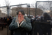 A protester turns his back to Washington D.C. police after they doused him with pepper spray after a barricade along Pennsylvania Avenue was pulled down during the inaugural parade in Washington, D.C., Friday, January 20, 2005.