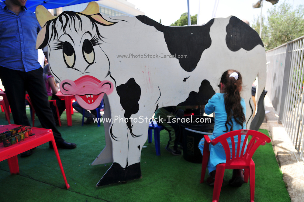 Israel, Haifa, Municipal Theatre Children's Play festival cow milks a cardboard cow