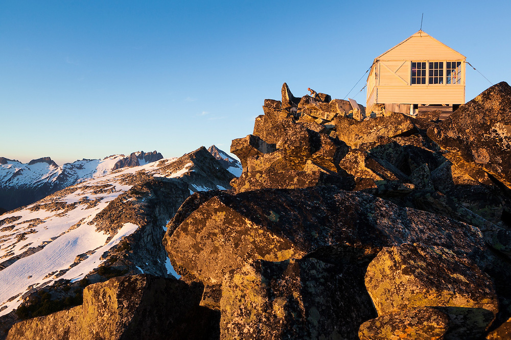 Stephen Byrne stands outside the fire lookout cabin on the summit of Hidden Lake Peaks, North Cascades National Park, Washington.