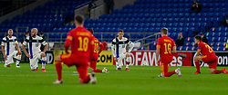 CARDIFF, WALES - Wednesday, November 18, 2020: Finland's Robert Taylor kneels down (takes a knee) in support of the Black Lives Matter movement before the UEFA Nations League Group Stage League B Group 4 match between Wales and Finland at the Cardiff City Stadium. Wales won 3-1 and finished top of Group 4, winning promotion to League A. (Pic by David Rawcliffe/Propaganda)