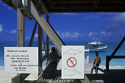 sign at Club Med beach warns visitors against touching JoJo, a wild sociable bottlenose dolphin, or ambassador dolphin, Tursiops truncatus,  Providenciales ( Provo ), Turks and Caicos Islands ( Western Atlantic Ocean )