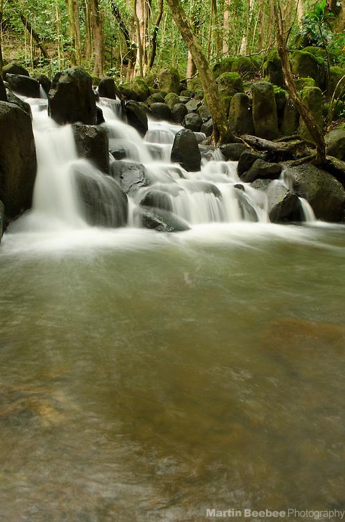 Cascading waterfall and pool on the hike to Secret Falls, Kauai, Hawaii