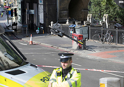 © Licensed to London News Pictures. 05/06/2017. London, UK. A broken traffic light marks the spot on the southern end of London Bridge where a white van crashed following a terrorist attack in Saturday evening. Three men attacked members of the public  after a white van rammed pedestrians on London Bridge.   Ten people including the three suspected attackers were killed and 48 injured in the attack. Photo credit: Peter Macdiarmid/LNP