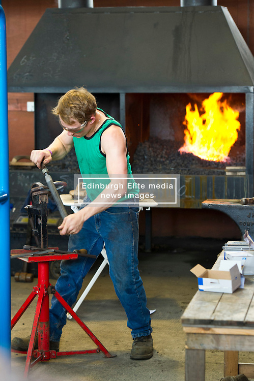 Pictures: The Forge was popular as ever as blacksmiths showed off their skills at shoeing very patient horses.<br /> <br />  The crowds gathered at the Royal Highland Show today as all things farming were on display. The sunshine and showers weather did not disuade visitors  to open their wallets and purses as they toured the 4,000 stands available<br /> <br /> Ger Harley: Edinburgh Elite media