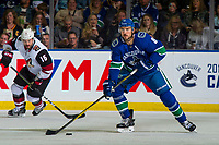 KELOWNA, BC - SEPTEMBER 29:  Christopher Tanev #8 of the Vancouver Canucks skates with the puck against the Arizona Coyotes at Prospera Place on September 29, 2018 in Kelowna, Canada. (Photo by Marissa Baecker/NHLI via Getty Images)  *** Local Caption *** Christopher Tanev;