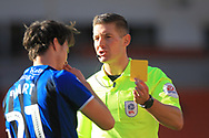Sam Hart is booked by Rob Jones during the EFL Sky Bet League 1 match between Blackpool and Rochdale at Bloomfield Road, Blackpool, England on 6 October 2018.