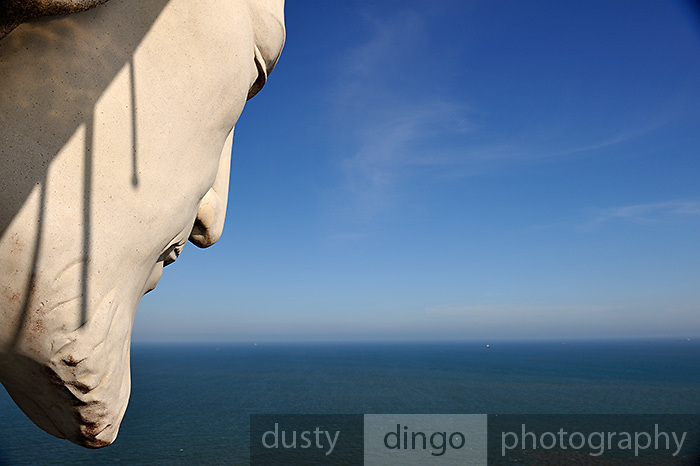 "Face of ""Christ of Vung Tau"" overlooking the South China Sea. ""Christ of Vung Tau"" is a statue of Jesus standing on Nui Nho (Tao Phung, or Little Mountain), in Vung Tau. Built between 1974 and 1993, it is 32 metres (105 ft) high, standing on a 4 metre (13 ft) high platform, for a 36 metre (118 ft) total monument height, with two outstretched arms spanning 18.3 metres (60 ft). There is a 133-step staircase inside the statue leading to observation points on both shoulders. Vung Tau, Vietnam"