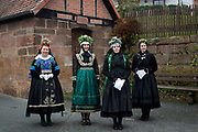 vl: Marburger Tracht (Katholisch), Brautmädchen, Marburger Tracht (evangelisch), Braut in der Schönsteiner Amtstracht aus dem Gilsberger Hochland (evangelisch)<br /> <br /> Members of the 'Hessische Vereinigung für Tanz- und Trachtenpflege Fachgruppe Brauchtum und Trachten' is wearing an original traditional bridal costume in Marburg, Hesse, Germany on November12, 2016.<br /> <br /> This evangelical traditional costume is from around 1920. Marburg is one of the few areas in Germany where women still wear a traditional costume (around 80 nowadays).<br /> Only pristine women were allowed to wear the bridal crown.<br /> <br /> This is part of the series about Traditional Wedding Gowns from different regions of Germany, worn by young members of local dance groups and cultural associations that exist to preserve and celebrate the cultural heritage. The portraiture series is a depiction of an old era with different social values and religious beliefs in an antiquated civil society with very few of those dresses left.