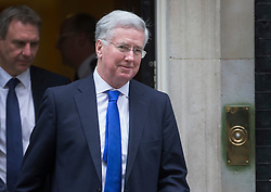 © Licensed to London News Pictures. 09/02/2016. London, UK.  Michael Fallon, Secretary of State for Defence, leaves number 10 Downing Street after attending a cabinet meeting. Photo credit: Peter Macdiarmid/LNP
