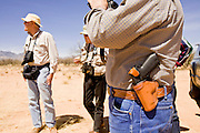02 APRIL 2006 - THREE POINTS, AZ: Minuteman volunteers scan the desert for signs of illegal immigrants during the Minuteman Project action on Elkhorn Ranch Rd. between Three Points, AZ, and Sasabe, AZ, about 60 miles south of Tucson, AZ, April, 2, 2006. Volunteers from the Minuteman Project have set up lines of observation posts on remote county roads in the desert southwest of Tucson to monitor the area for illegal immigrant traffic. On Saturday night, the first night of the action, Minuteman volunteers spotted more than 50 illegal immigrants and claim their tips to the US Border Patrol led to the apprehension of at least 16 of those immigrants.  Photo by Jack Kurtz