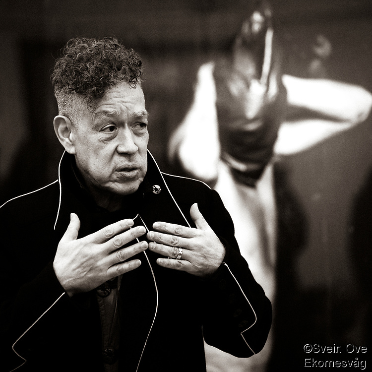 Andres Serrano in front of his artwork in the Torture series.