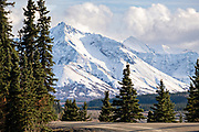 An early season snow dusting the Alaskan Range of mountains at the Teklanika River in Denali National Park, McKinley Park, Alaska